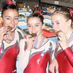 Gymnastiqye, championat de France 2013, médaille de gronze pour trio fédéral composé d'Éléonore Gach, Elsa Ladet et Alicia Mennechet / © Tempo Gym